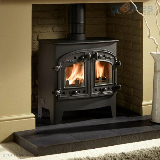 What does the heat output of a wood-burning stove mean